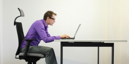 man sitting at laptop computer