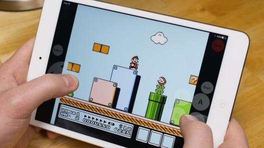 iPad playing retro Super Mario game