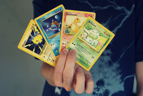 holding pokemon cards